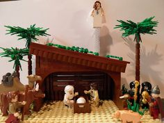 Lego nativity scene-I love that Joseph is Obi One Kenobi and that one of the wise men is giving C3PO's head as a gift.    Other instructions on how to create a lego nativity scene: http://staff.science.uva.nl/~leo/lego/nativity.html