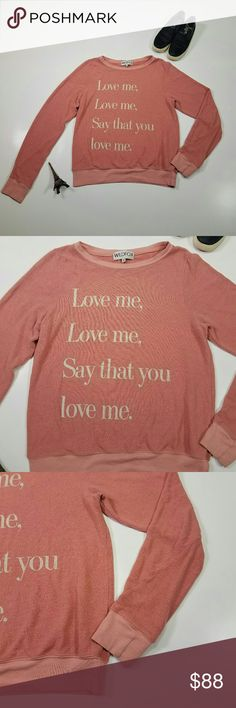 "Wildfox Small Womens Love Me Sweatshirt Gently used with typical wear.  Nice seam detail on sleeve This looks to be sold out on the Nordstrom website and has a brushed fleece texture.  So it looks like it has a worn pilling texture, but that is the nature of the fabric.  Here is the website description: ""'90s song lyrics and a sweatshirt-style silhoutte lend an old-school vibe to a ribbed-edge pullover cut from lightweight brushed fleece"" Measurements Laying Flat: Chest(armpit to armpit)…"