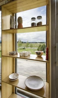 View through window of shipping container converted to summer house; Gardenista