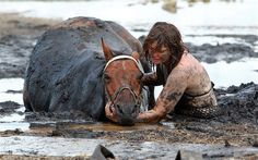 An Australian woman stayed with her horse as the tide closed in while the animal was trapped in the mud for three hours.