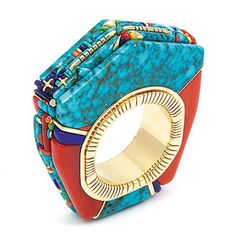 """The new exhibit at the Smithsonian's National Museum of the American Indian, """"Glittering World: Navajo Jewelry of the Yazzie Family."""" For jewelry lovers the exhibit makes a great starting point for a holiday visit to NYC; don't miss it if you are a fan of the December birthstone turquois. Turquoise and Coral Ring by Raymond C. Yazzie"""