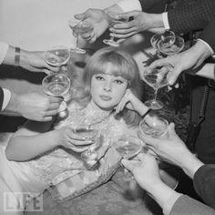 Champagne toast with Mandy Rice Davies