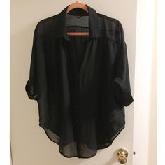 Guess Sheer Dolman Top Sheer black button down shirt with dolman sleeves. Soft slippery fabric. Brand new, perfect condition, worn maybe once. Sleeves go halfway down the arm. The fit is intended to be loose. Guess Tops Button Down Shirts