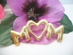 gold tone MOM pin by ALEXLITTLETHINGS on Etsy, $11.99