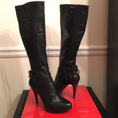 "Nine West Tall Boots HP Work Chic Welcome fall & strut right through the holidays in these new in the box gorgeous black patent tall boots by Nine West. Step up any outfit in these 4"" heels with 1/2"" platform. Will take you from the office to a perfect evening out-- guaranteed to add a bit of glam, pop & shine! Excellent condition with ankle wrap & back tie detail. Notice they have a half-zipper, so they do not unzip from the top. You unzip, pull on & then zip.  ✨No trades please✨ Nine West…"