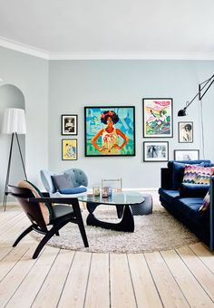 Colourful wall gallery creates a nice contrast to the fainted light blue colour on the wall.
