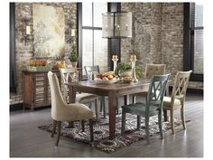 Shop for Signature Design Rectangular Dining Room Table, D540-125, and other Dining Tables at Ashley Furniture Home Stores in San Diego, CA. D540-125 is made with pine veneers and solids in a textured dark brown color. D540-160 is made with pine veneers and solids in a textured dark brown color with color accents on doors.