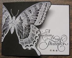 handcrafted card from Stampin' on the Prairie ... black and white ... big Swallowtail butterfly emboss in white on black cardsock ... card front cut in to butterfly wings ... sentiment stamped on inside shows when card closed ... great card! ... Stampin' Up!