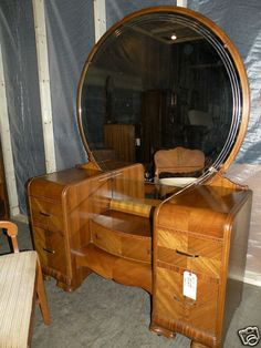 we're inheriting some antique waterfall furniture for our guest bedroom.  looks a little like this...