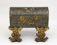 Chest with later two-part gilded stand  early 17th century      Momoyama or Edo period    Black lacquer and gold flakes on wood, with mother-of-pearl, gold, silver, and gilt-copper fittings; gilded wood (namban, maki-e)  H: 53.3 W: 106.3 D: 45.3 cm  Japan    F1979.50a-c