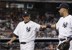 GAME 72: Monday, June 25, 2012 - New York Yankees shortstop Derek Jeter, right, congratulates starting pitcher Hiroki Kuroda as Kuroda leaves the mound after the top of the fifth inning of the baseball game against the Cleveland Indians at Yankee Stadium in New York.
