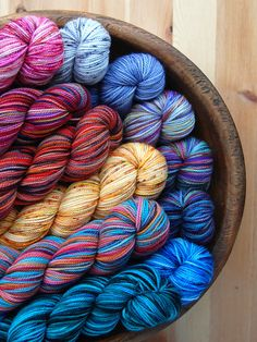 Display like this with note that more skeins available in each dyelot. Looks pretty & saves space. Have bulk stored in drawers.