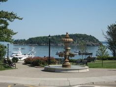 Bar Harbor, Maine. Ive lost count now how many times I have sat on the hill directly behind this fountain to watch the boats and soak up the sunshine-beautiful spot!
