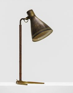 PaaVo Tynell | Table lamp | Manufactured by Taito Oy, Finland | 1950 | Brass and leather