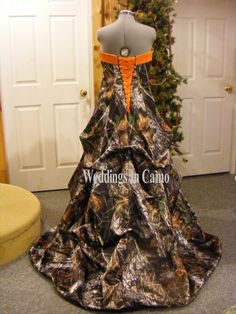 WEDDINGS IN CAMO.com Our best selling princess line, CAMO dress with pickups and a semi-cathedral length train (60.5 inches from the waist). CAMO Colors--choose your CAMO color for the dress. Your dre