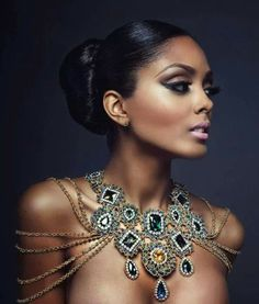 The poise of her neck, and not the misdirection of the jewels, makes an ordinarily exotic face entirely regal.
