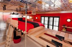 A room that gives an active and personalized experience for a boy where in an elevated bed is used in order to have a play area under it. Description from homedesignlover.com. I searched for this on bing.com/images