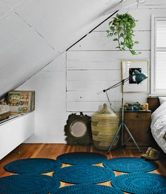 Like the rest of his eclectic Vancouver home, designer Omer Arbel's attic bedroom features a mix of vintage and new furniture. A light by Bretford in Chicago is next to an Ikea Malm bes topped with linens and folk weavings from India. The rug is by Paola Lenti. Photo by: Jose Mandojana