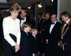Princess Diana, Prince William and Prince Harry saying hello to Robin Williams, Phil Collins and Bob Hoskins at the opening night of the movie 'Hook' in 1992