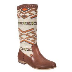Nava.  I love these.  Ordered them for Fall.  The perfect boot for when the leaves are falling :)