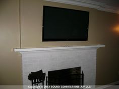 """52"""" TV with hidden audio/video sources.  No need to keep all the messy gear near.  All components can be hidden away (even in a closet). ~ flat panel tv hang over fireplace  