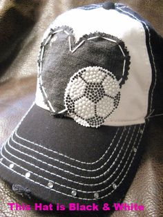 **THIS HAT IS BLACK/WHITE!! this hat is not grayish!! !!PLEASE READ MY SHIPPING TIME DETAILS ON MY ETSY SHOP HOME PAGE BEFORE ORDERING!! PLEASE READ FULL ITEM DESCRIPTION AND DESIGN OPTIONS BELOW: Please look at all pictures posted in listing!!  This item description: **THIS HAT IS BLACK/WHITE!! this hat is not grayish!! This super cute LOVE SOCCER cap is described: **Black and white two tone adjustable ball cap. Distressed on bill only **Black or blackish heart, stitched. **Rhinest...