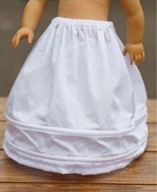 Sew a Slip for an 18-Inch Doll - YES!! A free tutorial on how to sew a corded crinoline (or petticoat) for an accurate mid-1800s girl's undergarment. Addy, Cecile, or Marie-Grace. Will replace elastic with a waistband, shorten to girl appropriate length, use cording instead of boning for more rows.