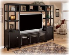 Chic black entertainment center with lots of storage & shelves.