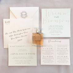 This is our Bronson wedding invitation suite with a belly band. In the sample photos we have used ivory and peachy pink metallic cardstock with gold and blush pink ink and peachy pink metallic envelopes. All colors and text are customizable for your order. PRICING BASED ON QUANTITY: 35-49: