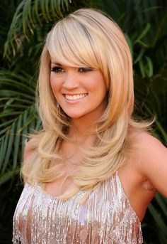 Layered blonde hair with side swept bangs