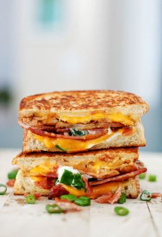 "Carbs on carbs is the way to go for an extra-rich grilled cheese. Just add thinly sliced potatoes, bacon, sour cream, and chives to your grilled cheese for a full-on, loaded up ""Baked Potato"" experience. Click through for the recipe and more grilled cheese recipes that would be great for your kids' school lunches."