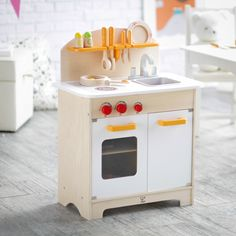 Hape White Gourmet Chef Kitchen with Accessories - The White Gourmet Chef Kitchen with Accessories includes everything your child needs short of formal culinary training for safe, realistic kitchen pla...