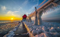Lighthouses consumed by ice at Grand Haven Pier in St Joseph, Michigan