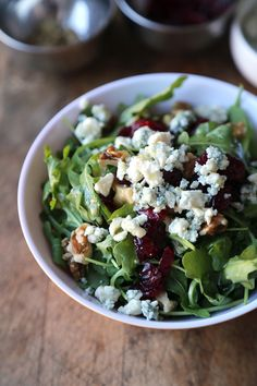 A classic arugula salad with walnuts, blue cheese and cranberries. See how each ingredients from this simple arugula salad recipe can benefit your health.