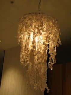 button chandelier. I love this idea. But would rather it fall a little better.