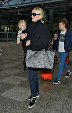 Cate Blanchett holds on tight to cherubic daughter Edith as she returns to the UK with her brood - 12 January 2016