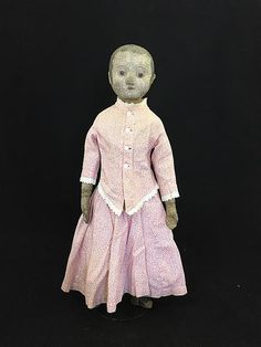 "19"" IZANNAH WALKER, AMERICAN CLOTH DOLL. PRESSED OIL-PAINTED STOCKINET SHOULDER HEAD WITH BROWN PAINTED HAIR AND TWO LONG RINGLET SIDE CURLS. OUTLINED EYES, LIGHTLY STROKED BROWS, ROUNDED PUG NOSE AND CLOSED MOUTH, STITCH SHAPED EARS, OIL-PAINTED ARMS, HANDS WITH APPLIED THUMBS. OIL-PAINTED LOWER LEGS WITH PAINTED BLACK BOOTS. APPROPRIATE CLOTHES. ANTIQUE UNDERGARMENTS."