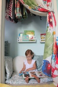 This is more realistically what would be in our house. Love the idea of a closet reading nook- the colorful curtain rather than door is a great touch  #PrimroseReadingCorner