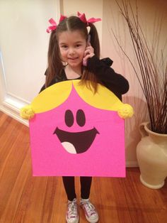 Home made Little Miss Chatterbox costume for Book Week. Made with cardboard, some wool for pigtails & thick black ribbon to tie at shoulders.