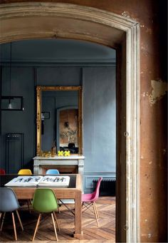 madabout-interior-design: The great home/ studio of French fashion photographer Fred Meylan, in Paris In rue Saint-Honoré, a former upholsterer atelier became the apartment of the fashion photographer Fred Meylan. Both home and workplace, this intimate and meeting space meets old and new, with its original battered walls and worn floors, vintage pieces and design icons, becoming the perfect backdrop for some of his best photos.