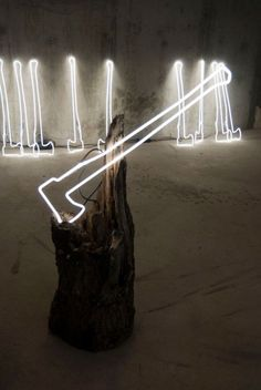 Illuminated Ax in neon lights  This piece is so strong.  Simplicity wins, and so does mixing medias with light.