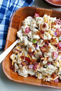 Bacon Ranch Tortellini Salad is a party perfect pasta salad that pairs cheese-filled tortellini with fresh veggies, cheddar cheese, cool ranch dressing, and lots of crisp crumbled bacon!