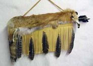 """Cherokee Flat Full Red Fox Quiver with Arrows - 27"""". This beautiful buckskin and full red fox pelt quiver comes with two arrows and a braided strap. The quiver is trimmed with natural feathers and wooden beads. Each quiver will differ with leather color, fur and feathers. This artifact is handcrafted by Cherokee artist, Wetfoot, and comes with a Certificate of Authenticity.  $229.95"""