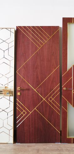 The original interior door in the art deco style by Stavros. Аmerican walnut veneer. Brass insert decor.