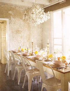 Rough plaster walls, pretty chandelier, vintage painted dining table and metal tolis chairs     Dining+Room.Amy+Neunsinger.jpg