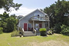 Corrines Downstairs is an Ocracoke Island duplex rental. From the front porch, this lower level suite offers fantastic views of Silver Lake harbor located directly across the street.