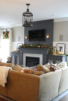Sherwin Williams Peppercorn (fireplace) and Analytical Gray (walls)