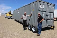 Tri-city area residents Gary Gates and Chris Christiansen have invented a way to pick up, move and drop off any size ISO (International Standards Organization) shipping container with nothing more than a tow truck and a few of their own small inventions. Shipping Container Storage, Shipping Container Buildings, Cargo Container Homes, Container Shop, Shipping Container Home Designs, Building A Container Home, Container Cabin, Storage Container Homes, Container House Design