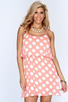 Theres no doubt that a fashionista like you can take a versatile piece from your closet, like this polka-dotted dress, and make it your own every time! Paired with patent black flats that coordinate with the subtle piping along the bodice, a cherry-red, beaded necklace, and a floral envelope clutch, this darling design is sure to flaunt your fantastic fashion sense with the utmost style - no ifs, ands, or buts! This dress features scoop neck, sleeveless style, polka dot print, sheer overlay…