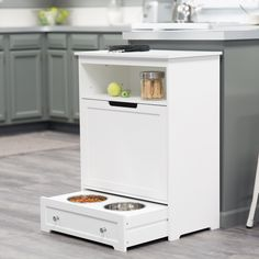 Boomer & George Pet Feeder Station - The Hayneedle-exclusive Boomer & George Pet Feeder Station will make you wonder how you ever did without its conveniences. Instead of digging down...